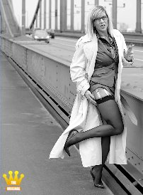 Lady Ewa At the Bridge [3000] : Maybe she once crosses the path with you on a similarly gloomy autumn day in this frivolous dress. With a trench coat over her grey costume, the Lady is posing with a garterbelt on a bridge over the river Rhine. To her sheer black nylonstockings she is wearing 16 cm high heeled classic pumps.