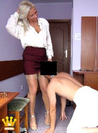 Lady Ewa Heels- and Nylongames with the Mistress [5027] : Just arrived in the hotel room, the nylon-Mistress is expected from a naked slave. He must first kneel before the Lady and kiss her legs and feet. Then he is allowed to lick the Lady