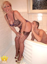 Lady Barbara In the Bathtub [5385] : Today, I visit member Fred in Duesseldorf in his bath tub. Immediately I undress when the door is closed, and only in sexy lingerie, nylons and platform sandals I stretch my butt to his face and let him smell and lick my ass and pussy, before he gets my pee. My pusssy was already wet when I was sitting in my car, because I love young men. At the end I still give a footjob with my nylon feet to this horny, young stallion. But he is really cool on ass licking.