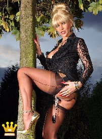 |9| Update 5715 Lady Ewa [5715] : Lady Ewa is doing a little private show in the garden for member Heinz. She presents the horny guy her 18 cm high gold pumps. The racy blonde from Poland is dressed very sexy with a black lace blouse and sheer nylons with seams. Her labia are pulled out with heavy weights on brackets, which makes Heinz especially horny. And next time, Heinz wants to bring heavier weights to stretch Ewa